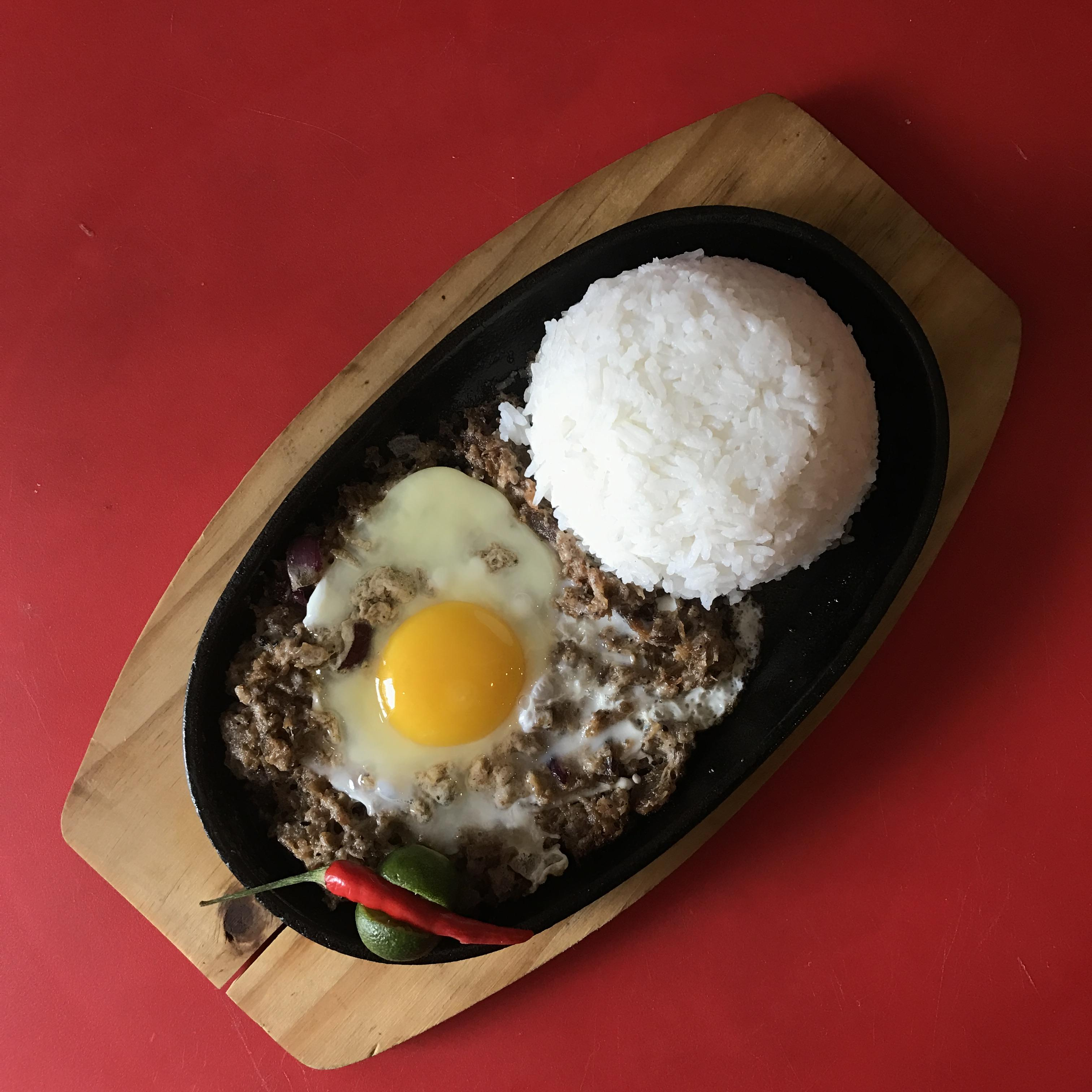 Sizzling Pork Sisig with Egg